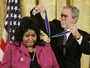 George W. Bush presents her with the Presidential Medal of Freedom in 2005.
