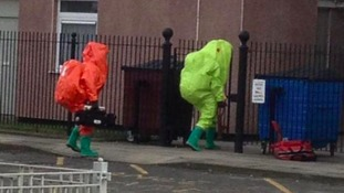 Teams in hazardous materials suits