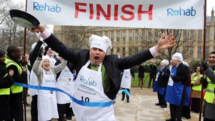 Conservative MP Tim Loughton crosses the finishing line victorious.
