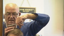 Barber hangs up scissors after six decades in the business
