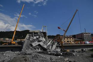 Debris is removed from the collapsed bridge.