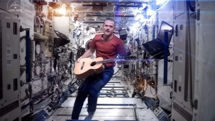 A Space Oddity? Commander Chris Hadfield performs in the ISS.