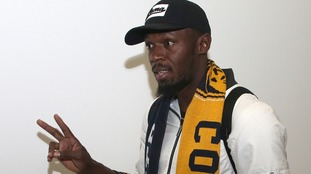 Usain Bolt arrives in Australia as he chases dream football career
