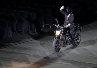 Indonesian President Joko Widodo arrives on a motorbike
