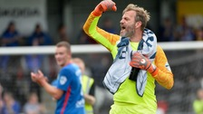 Linfield goalkeeper Roy Carroll celebrates his team's win over Crusaders