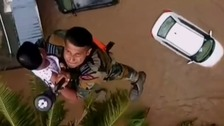 Young boy rescued by helicopter from flood-ravaged Indian state