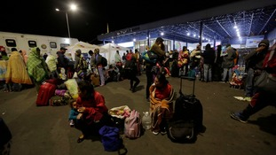 Dozens of Venezuelan immigrants wait from Ecuador authorities as to whether they will be allowed to enter the country.