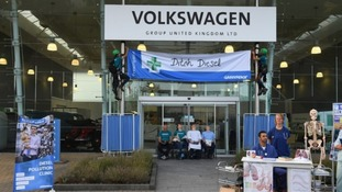 Activists blocked the doors of VW's HQ in Milton Keynes