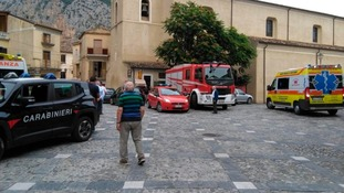 Rescue vehicles gather in Civita.