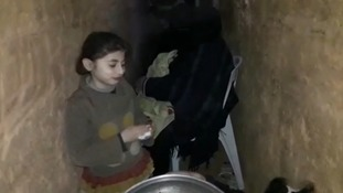 A family seeks shelter in one of the tunnels under eastern Ghouta.