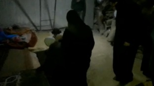 People head down into a tunnel under eastern Ghouta during the siege.