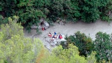 Search for survivors after gorge flooding kills 10 in Italy