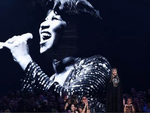 Madonna presents a tribute to Aretha Franklin, pictured on screen, at the MTV Video Music Awards at Radio City Music Hall.
