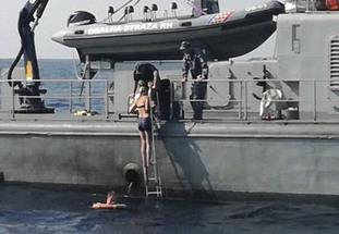 The passenger climbs aboard a Croatian Coast Guard ship some 60 miles from the Croatian coast