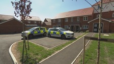 Police cars outside the flat in Omaha Close
