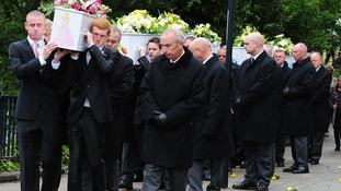 The funeral cortege of the Philpott children arrives at St Mary's RC Church in July 2012