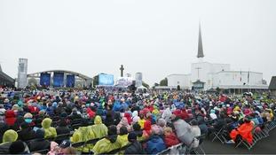 Pilgrims braved miserable conditions to hear the Pope speak.