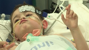Close up of young boy on hospital bed ready for operation