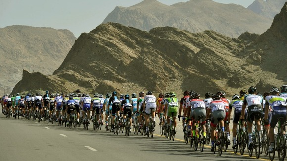 Cyclists compete in the 118-mile third stage of the Tour of Oman cycling race