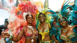 American actress Tatyana Ali (L) with her sisters on the final day of the Trinidad and Tobago Carnival
