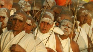 Newly initiated Sadhvis return to their camp after attending a ritual as part of the Kumbh Mela festival