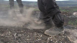 Pockets of embers still extinguished a month after the blaze on Saddleworth Moor was declared over