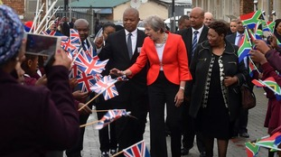 Theresa May greets schoolchildren
