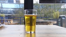 Pint of alcohol on table