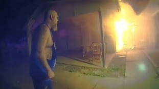 Police officer rushes into burning home to save six sleeping children and father