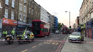 Police at the scene of the collision in Hackney.
