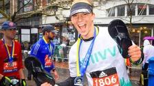 A delighted Chris celebrates finishing the Boston Marathon
