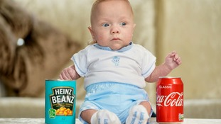 Theo Taylor weighed the same as a can of Coke at birth, making him the UK's smallest baby boy.