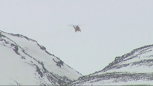 One of the RAF helicopters hovers over the Chalamain Gap area of the Cairngorms.