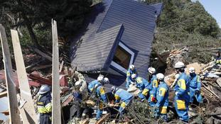 Rescuers search for survivors after deadly earthquake and mudslides hits Japan