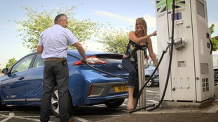 couple charge electric car