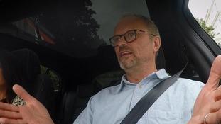 man in car gesturing