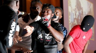 Drill rappers turned gospel artists 'Hope Dealers' perform on stage at a SPAC Nation event held at the Riverbank Park Plaza, London.