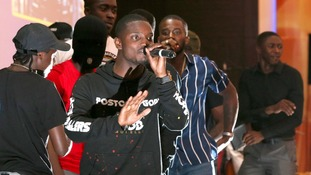 Drill rappers turned gospel artists 'Hope Dealers' perform on stage at a SPAC Nation event.