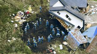 Dozens missing as rescuers dig for survivors after Japan earthquake