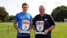 Jason Cummings (left) and Steve Evans (right) receive their awards.