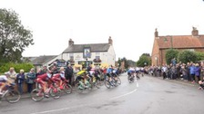 People in Woodbrough lined up streets to watch the world's top cyclists.