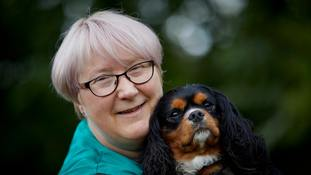 Sharon Hall and Moose, a Cavalier King Charles spaniel, one of the dogs used in sessions at a cafe to help people with mental health issues.