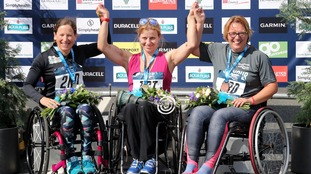 Poland's Martyna Snopek (centre) celebrates winning the Women's Wheelchair race during the 2018 Simply Health Great North Run.