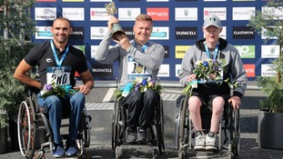 David Weir (centre) celebrates winning the Wheelchair Elite race during the 2018 Simply Health Great North Run.