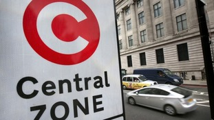 An image showing a sign for a congestion charge zone in London