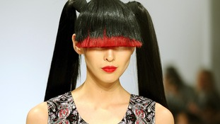 A model wears a design by Belle Sauvage during the autumn/ winter 2013 catwalk show