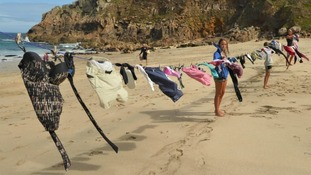 More than 60 abandoned clothing items displayed on Cornwall beach to raise awareness of risks to wildlife