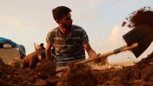 Rebel fighters dig in ahead of the final Syrian regime assault