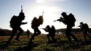 Soldiers from The Territorial Army London Regiment during a compound clearance exercise at Wretham Camp training area in Thetford, Norfolk.