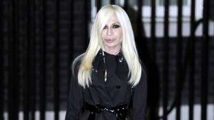 Donatella Versace arrives at a 10 Downing Street London Fashion Week reception.
